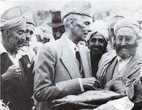 Quaid-e-Azam accepting a loaf of bread from tribesmen in Khyber Agency_thumb[3]